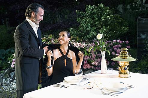 Germany, Bavaria, Couple having candlelight dinner - RNF000632