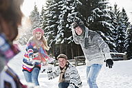 Austria, Salzburg Country, Flachau, Young people snow fighting in snow - HHF003657