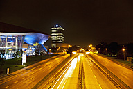 Germany, Bavaria, Munich, View of BMW Tower, BMW World, BMW Museum and Mittlerer Ring at night - FO003434