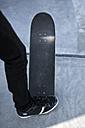Germany, North-Rhine Westphalia, Muenster, Skateboader standing at skatebowl at public skate park - KJF000150