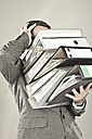 Close up of mature businessman at office holding stack of file - MAEF003434