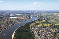 Europe, Germany, North Rhine-Westphalia, Mondorf, Niederkassel, Aerial view of river Rhine flowing nearby village - CS015280