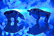 Close up of bear and bull figurine with blue fiber lights - TSF000311