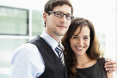 Germany, Bavaria, Diessen am Ammersee, Close up of young businessman and businesswoman standing together, smiling, portrait - JRF000273
