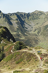 Austria, Kleinwalsertal, Mid adult man running on mountain trail - MIRF000261