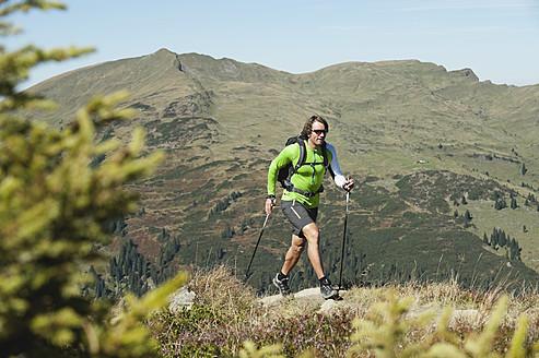 Austria, Kleinwalsertal, Mid adult man hiking on mountain trail - MIRF000267