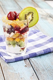 Close up of fruit salad on checked napkin - MAEF003562