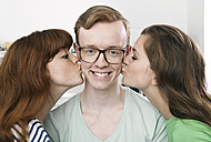 Germany, Berlin, Close up of young man and women kissing, smiling - WESTF016952
