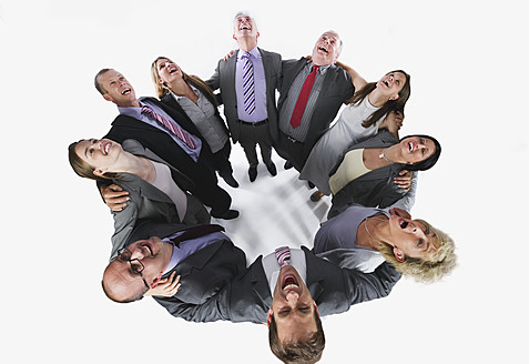 Business people forming huddle and looking up against white background - WESTF017012