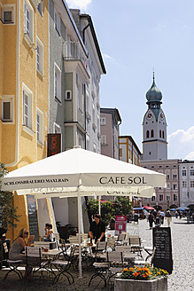 Germany, Bavaria, Upper Bavaria, Rosenheim, View of outdoor cafe with church in background - SIE001810