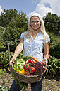 Germany, Bavaria, Altenthann, Woman with basket full of vegetables - RBF000707