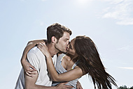 Spain, Majorca, Young couple kissing each other - WESTF017143