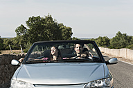 Spain, Majorca, Young couple travelling in cabriolet car - WESTF017161