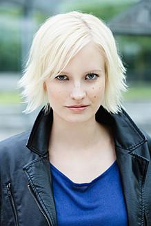 Germany, Bavaria, Munich, Young woman smiling, portrait - SPOF000020