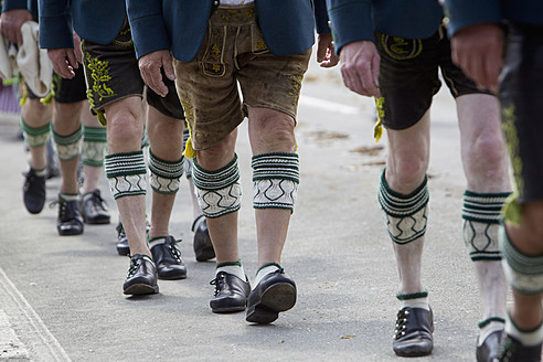 Germany, Bavaria, Chiemgau, Legs of men in traditional clothing, Haferl shoes and calf socks at Gaufest - FF001220