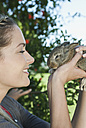 Italy, Tuscany, Young woman holding rabbit, close up - PDF000162