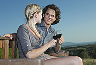 Italy, Tuscany, Young couple clinking wine glasses - PDF000210