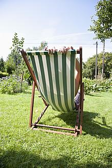 Germany, Hamburg, Woman relaxing in deck chair - DBF000172