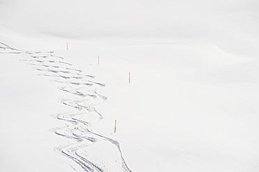 Austria, Zurs, Lech, View of ski tracks in snow - MIRF000275