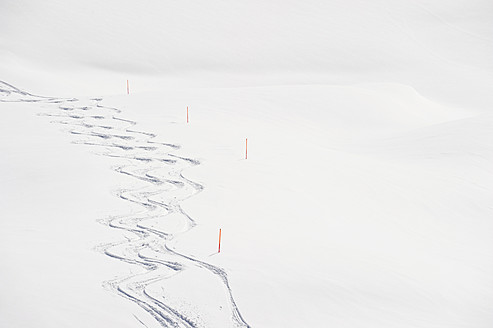 Austria, Zurs, Lech, View of ski tracks in snow - MIRF000275