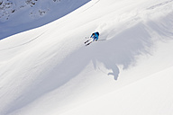 Austria, Zurs, Lech, Young man doing alpine skiing on Arlberg mountain - MIRF000287