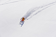 Austria, Young woman doing alpine skiing - MIRF000293