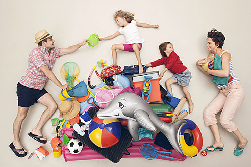 Germany, Artificial scene with family and beach toys - BAEF000323