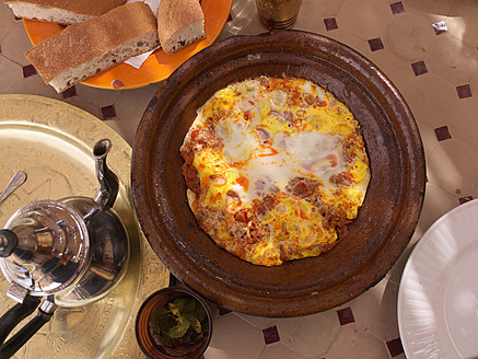 Morocco, Rissani, Tajine with eggs and a pot of tea - BSCF000068