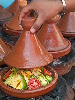 Morocco, Essaouira, Moroccan food on hot coals, close up - BSC000100