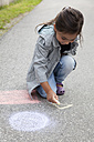 Germany, Bavaria, Huglfing, Girl drawing on street with chalk - RIMF000017