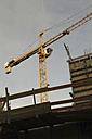 Germany, Berlin, View of crane on construction site - JMF000084