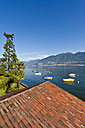 Switzerland, Ticino, View of roof with boats in Lake Maggiore - WDF001038