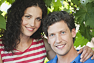 Germany, Bavaria, Couple smiling, portrait - WESTF017763