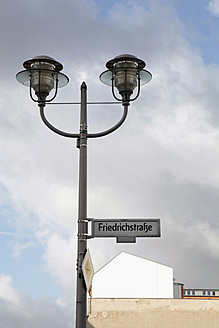 Germany, Berlin, Street light with friedrichstreet sign - JMF000095