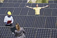 Germany, Munich, Engineer with man and woman in solar plant - WESTF017911