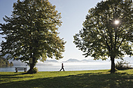 Germany, Bavaria, Walchensee, Senior woman walking - MIRF000351