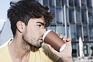 Germany, Cologne, Young man drinking coffee, close up - WESTF017971