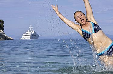 Greece, Ionian Islands, Ithaca, Woman swimming in sea, portrait - MUF001164