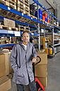 Germany, Bavaria, Munich, Manual worker in warehouse, portrait - WESTF018056