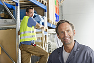 Germany, Bavaria, Munich, Manual workers working in warehouse - WESTF018071