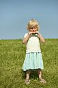 Germany, Bavaria, Girl eating watermelon, portrait - RNF000730