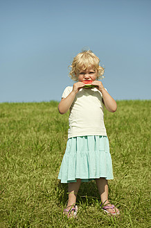 Germany, Bavaria, Girl eating watermelon, portrait - RNF000730