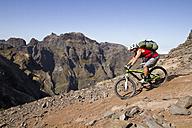 Portugal, Madeira, Mature man riding mountain bike - FFF001231