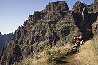 Portugal, Madeira, Mature man riding mountain bike - FFF001232