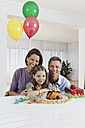 Germany, Munich, Family celebrating birthday, smiling, portrait - SKF000669