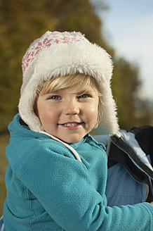 Germany, Bavaria, Girl smiling, portrait - RNF000802