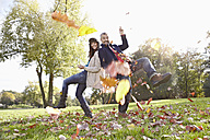 Germany, Cologne, Couple playing in park, smiling, portrait - RHF000044