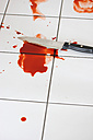 Blood and knife on tiled floor - HSTF000016