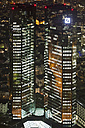 Germany, Frankfurt, View of Deutsche Bank with town at night - FO003778