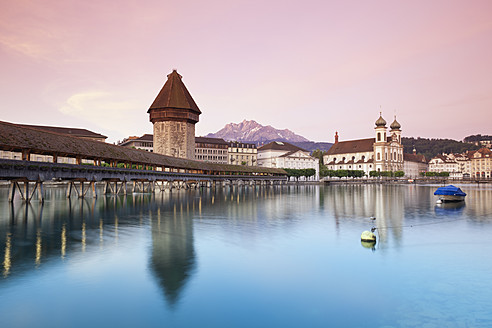 Switzerland, Lucerne, View of water tower, bridge and church in morning - MSF002490